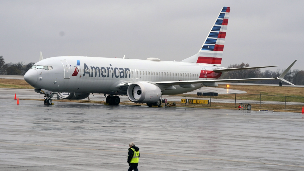 An American Airlines Boeing 737 Max jet plane parked at a maintenance facility
