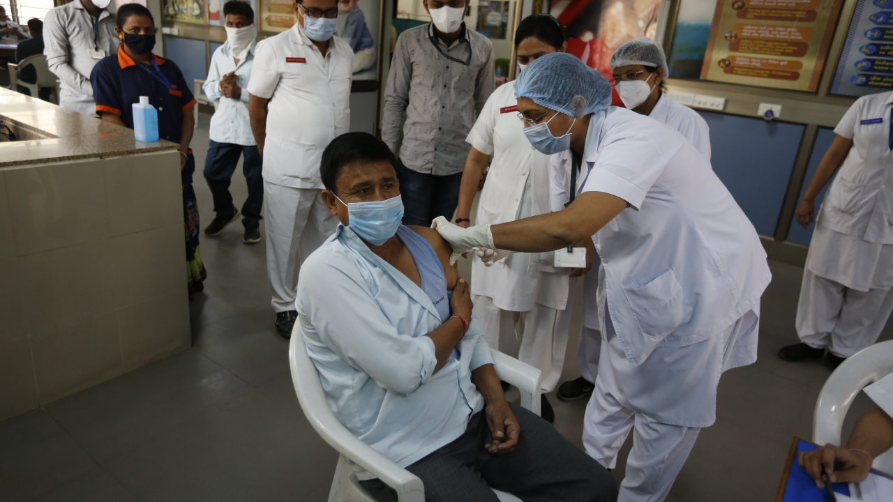 hospital staff receives a COVID-19 vaccine