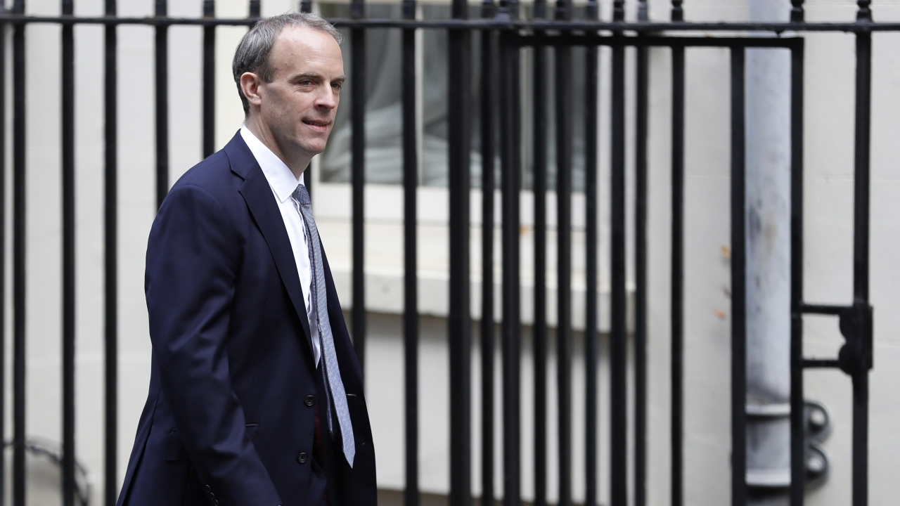 Britain's Foreign Secretary Dominic Raab walks down Downing Street