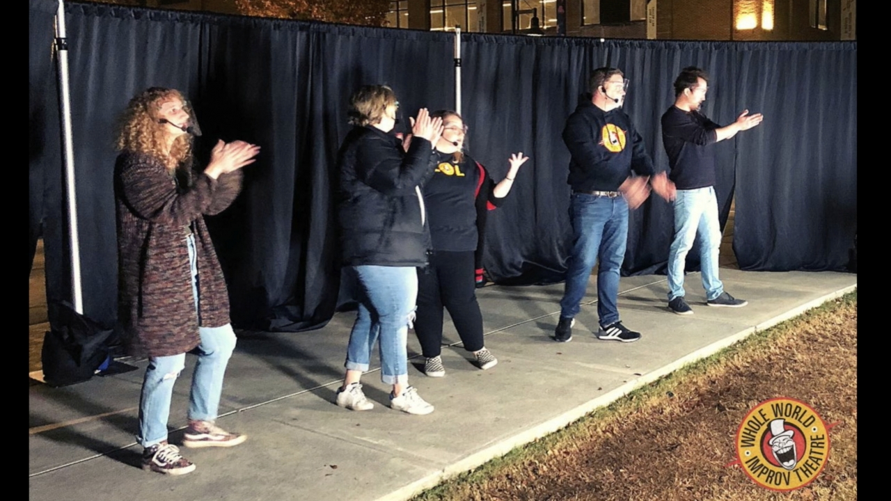Improv group performs outside