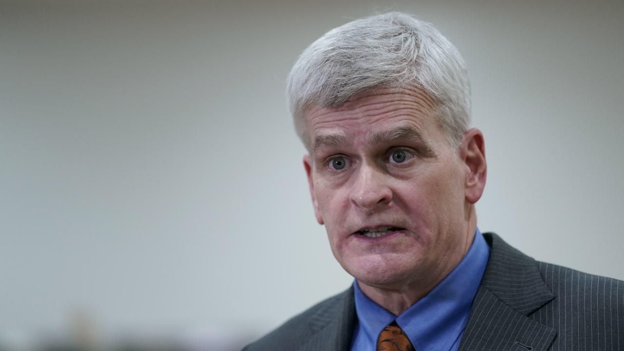 Sen. Bill Cassidy, R-La., talks with reporters on Capitol Hill in Washington.