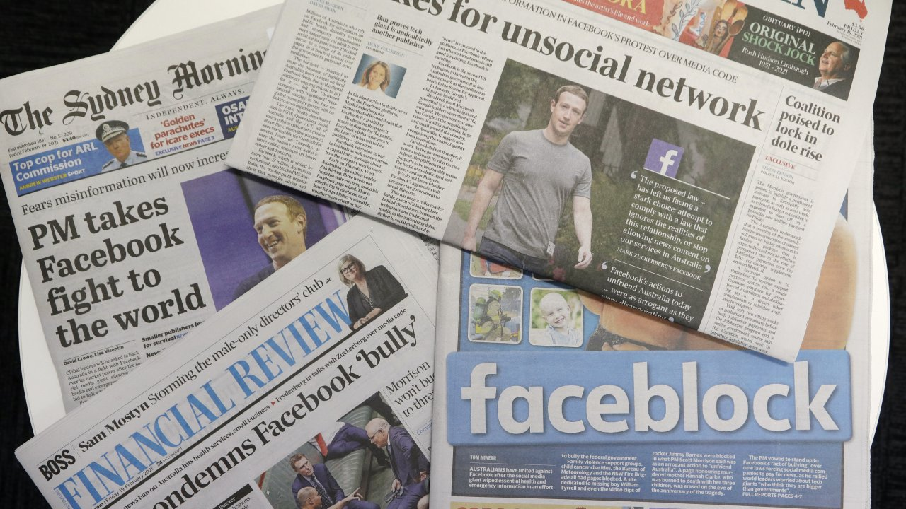 Front pages of Australian newspapers are displayed featuring stories about Facebook in Sydney.