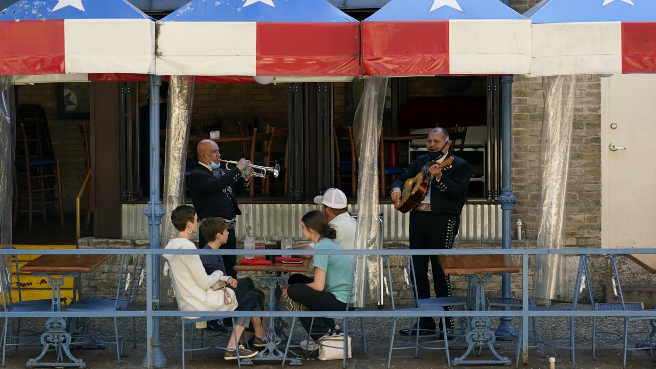 Mariachi perform for diners at a restaurant in San Antonio, Texas.