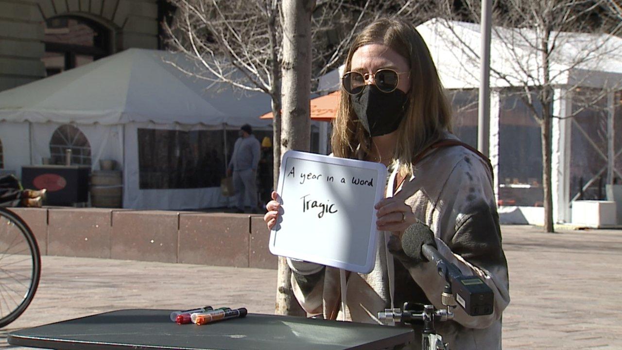 Woman writes on a white board.