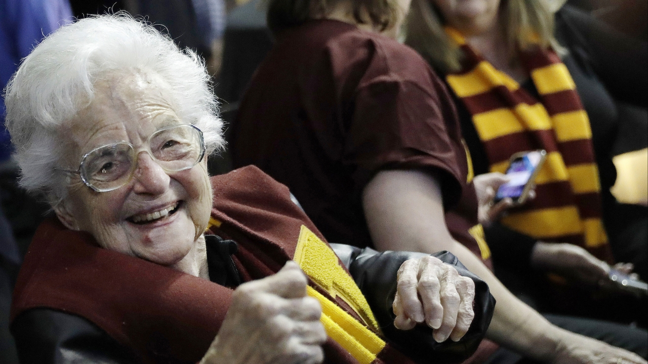 Sister Jean Dolores Schmidt sits with other Loyola-Chicago fans