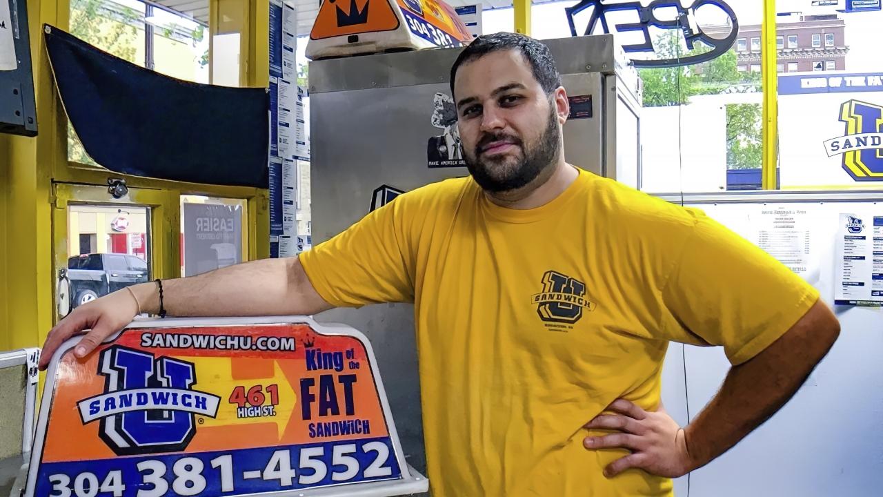 George Tanios at his sandwich shop in Morgantown, W.Va.