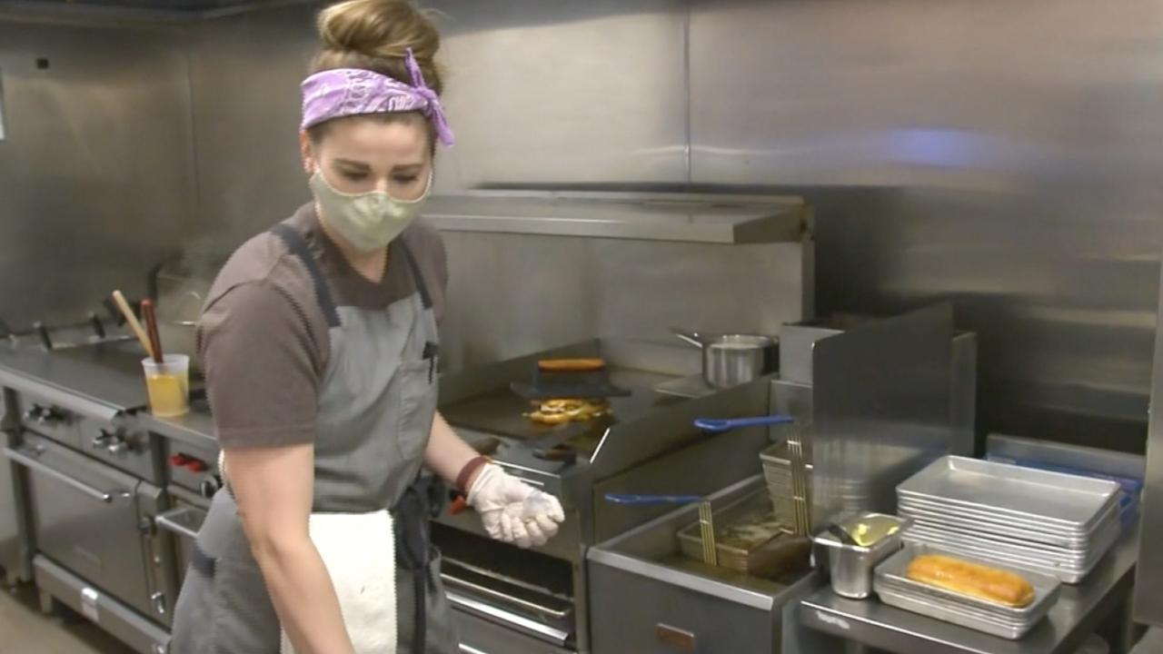 Person works in a restaurant kitchen