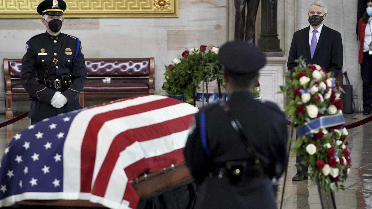 Officer William Evans lies in honor