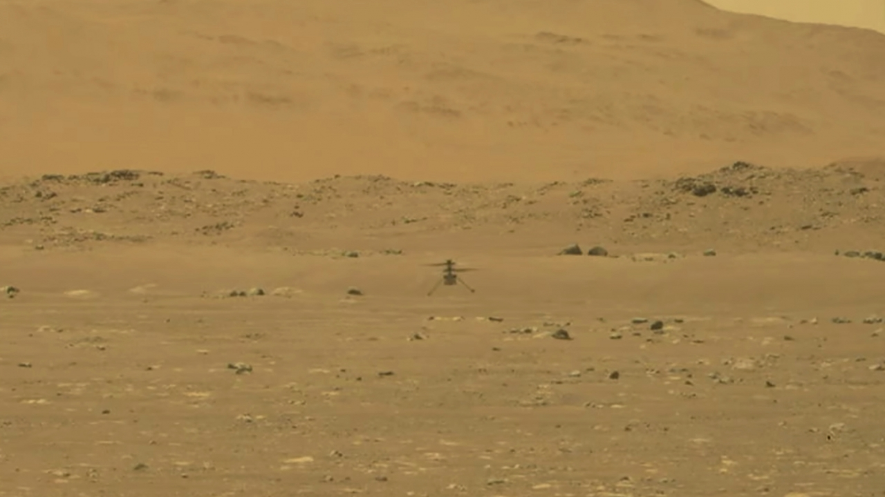 NASA's experimental Mars helicopter Ingenuity lands on the surface of Mars Monday, April 19, 2021.
