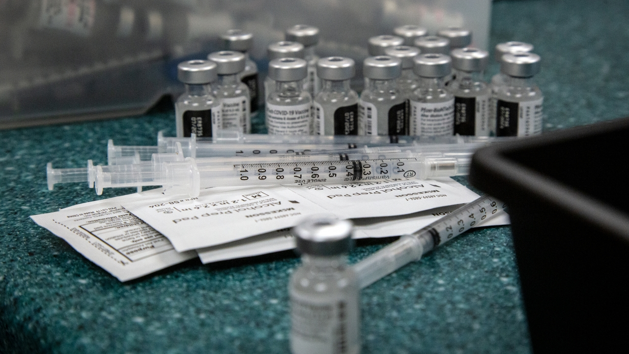 Doses of the Pfizer coronavirus vaccine are seen being prepared.