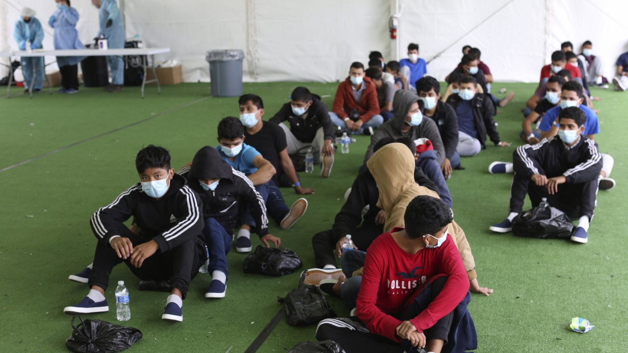Young migrants inside a border detention site