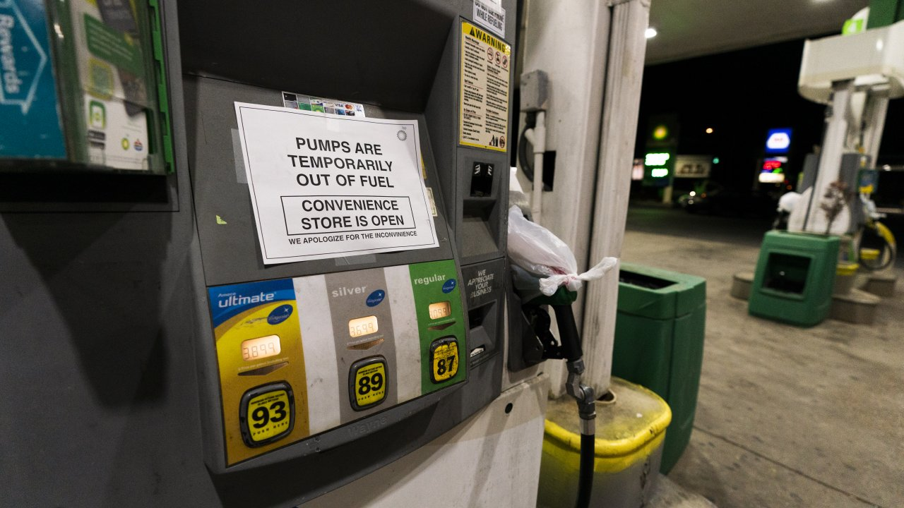 A pump at a gas station in Silver Spring, Md., is out of service, notifying customers they are out of fuel May 13, 2021.