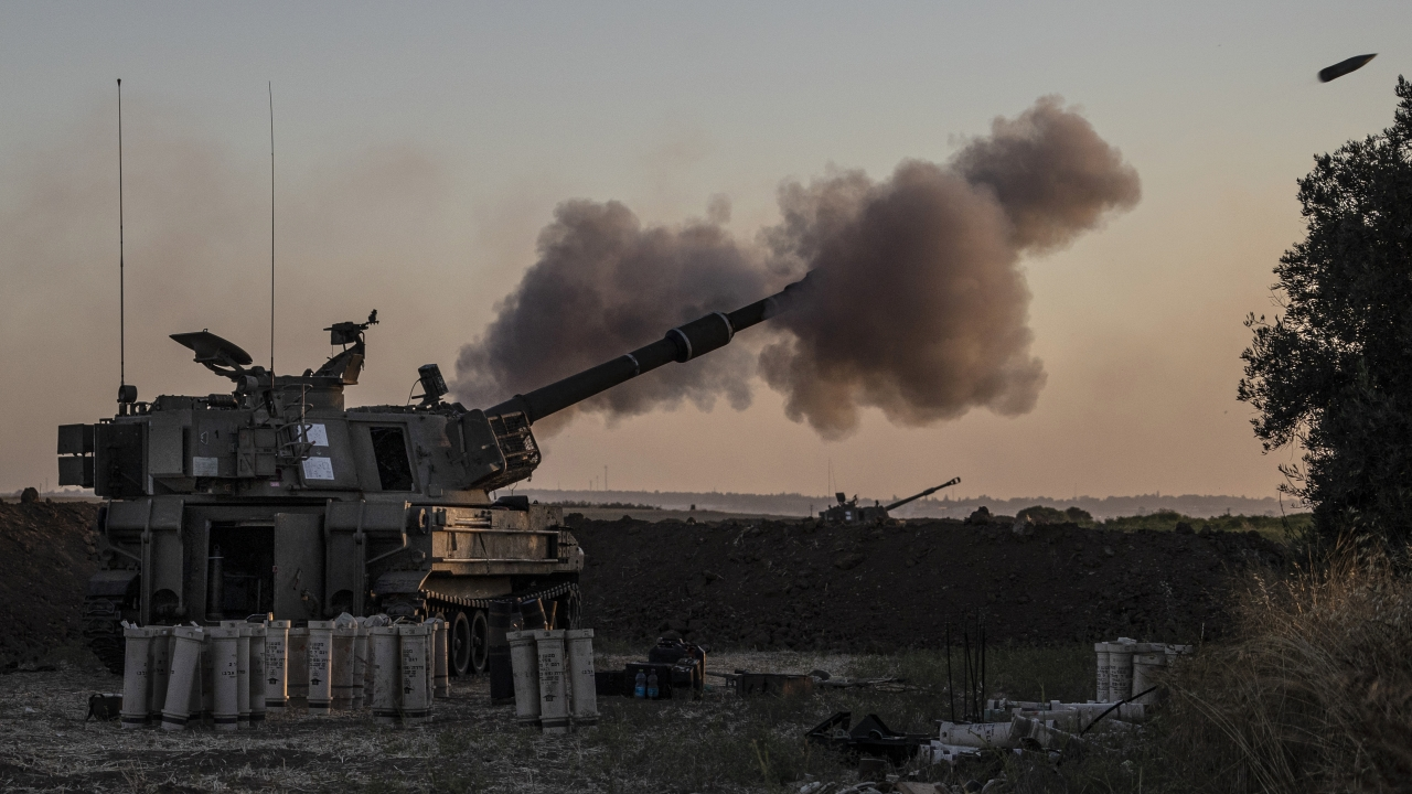 An Israeli artillery unit fires toward targets in Gaza Strip