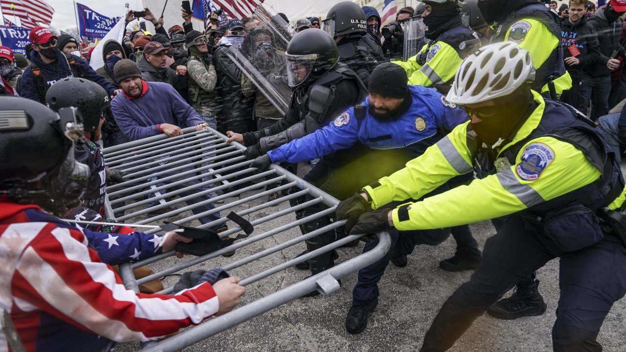 Trump supporters beset a police barrier at the Capitol in Washington during the Jan. 6 Capitol riot.
