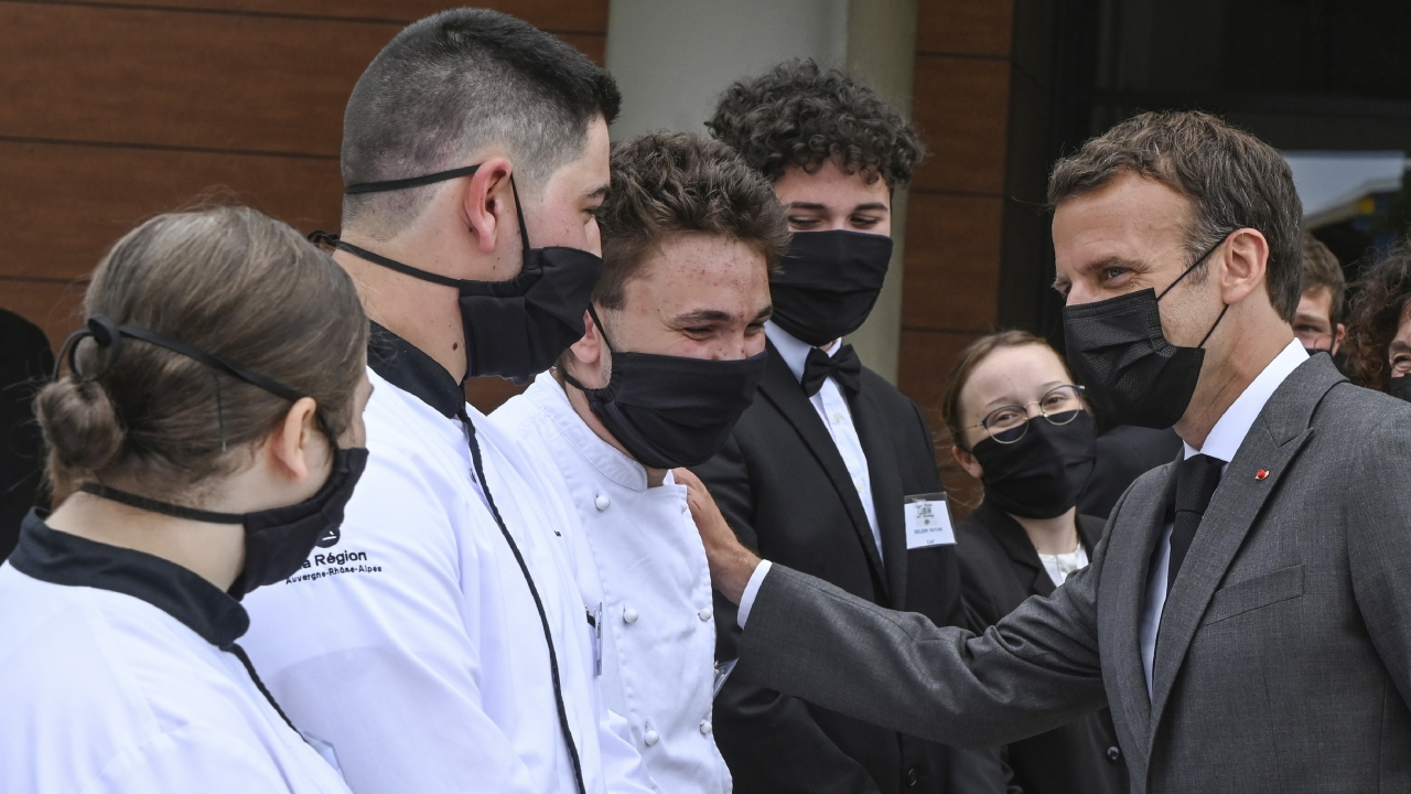French President Emmanuel Macron talks with cooking students, Tuesday June 8, 2021.