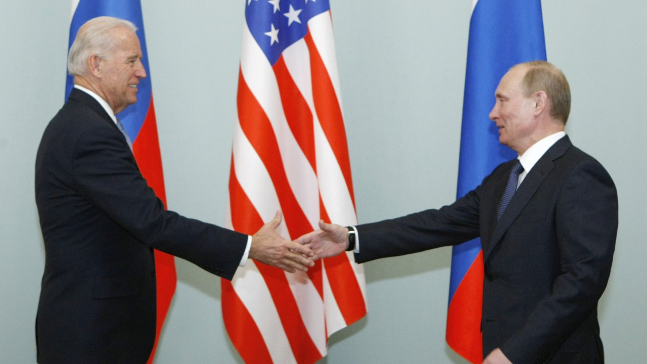 Then Vice President shakes hands with Russian Prime Minister Vladimir Putin in 2011.