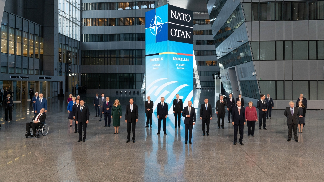 Leaders pose during a family picture at the NATO headquarters.