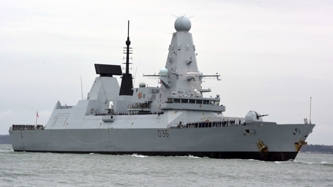 HMS Defender in Portsmouth, England. The Russian military says its warship has fired warning shots and a warplane dropped bom