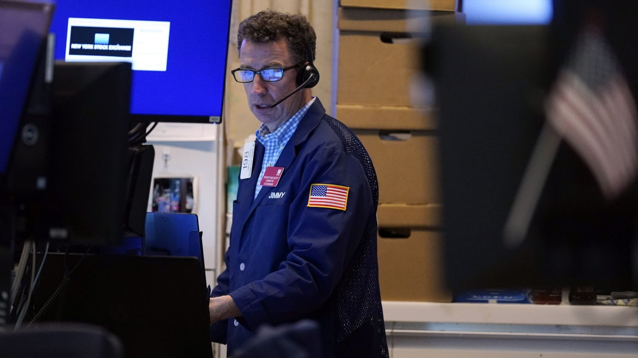 A trader works in his booth on the floor of the New York Stock Exchange