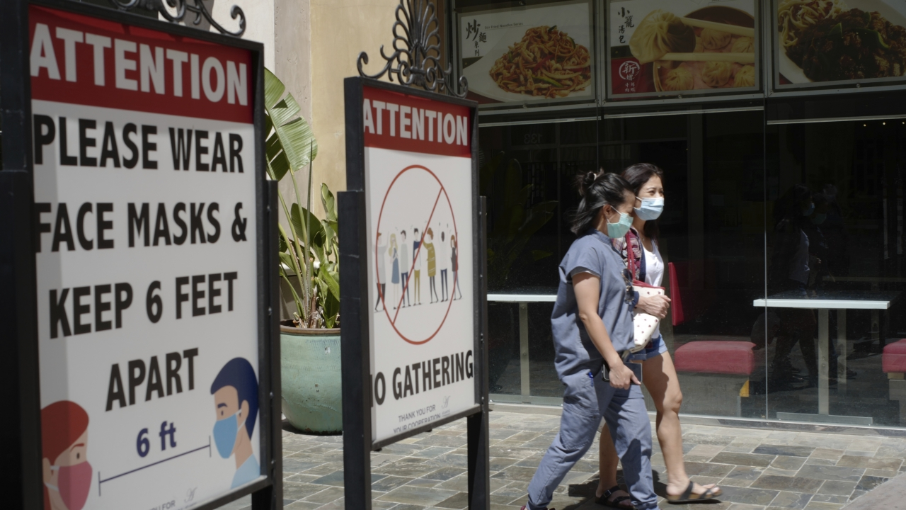 People wearing face masks at an outdoor mall in Los Angeles.