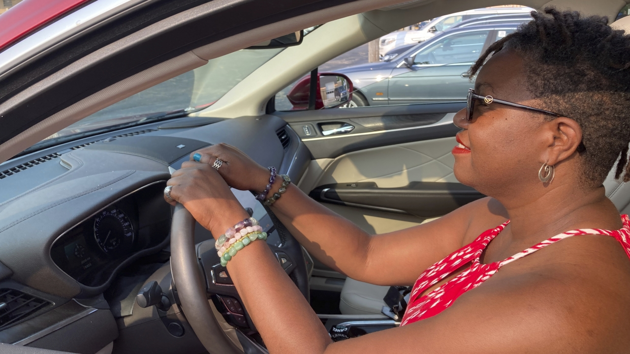 A woman sits behind the wheel of a 2019 Lincoln MKC.