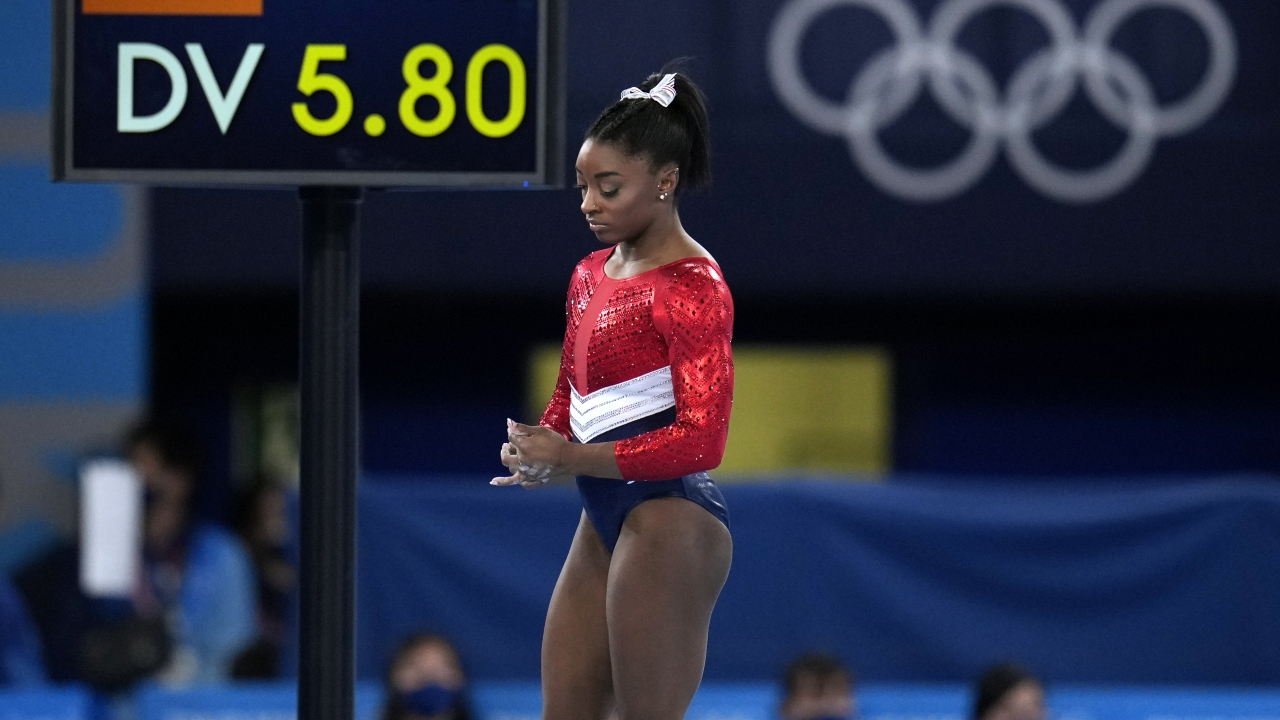 Simone Biles waits to perform on the vault during the artistic gymnastics women's final.