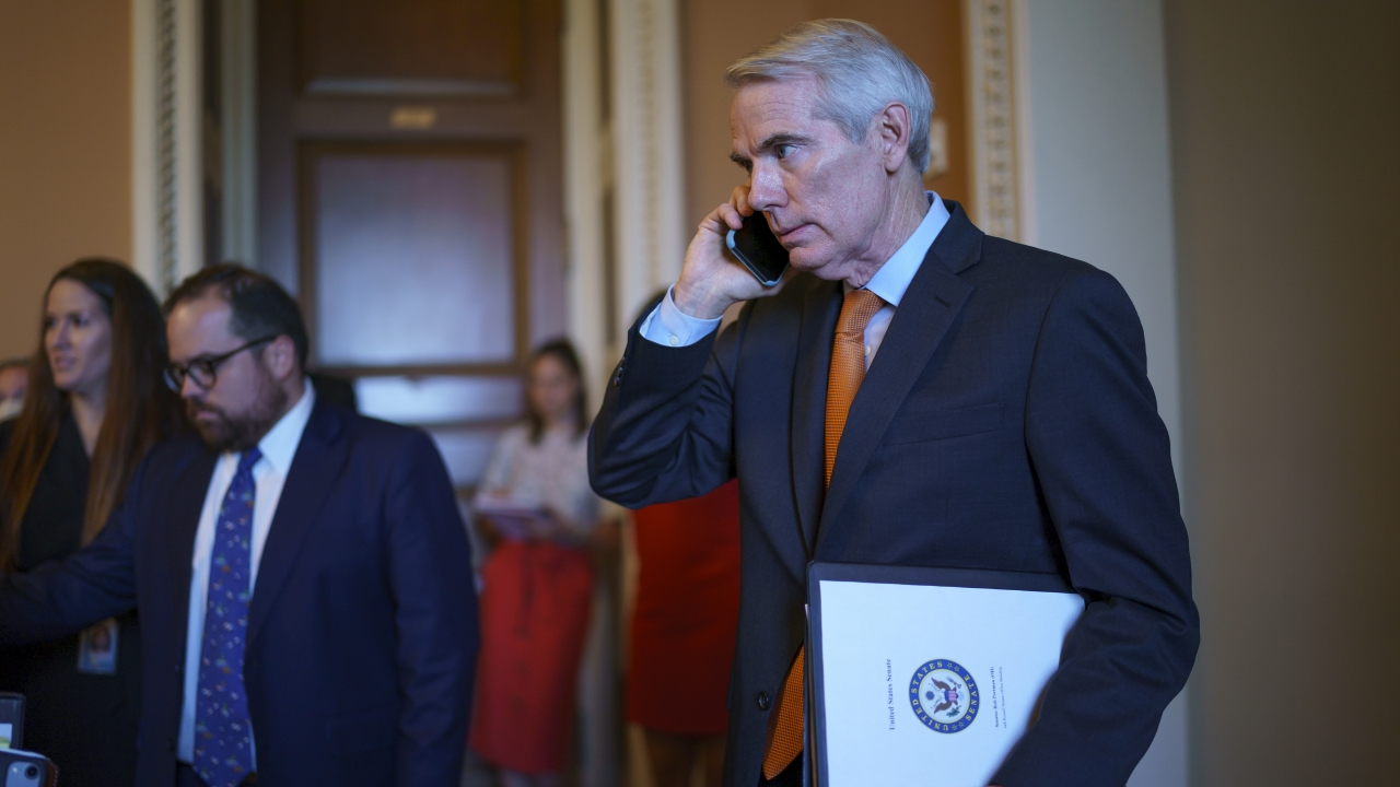 Sen. Rob Portman emerges from the office of Senate Republican leader Mitch McConnell to announce a deal.