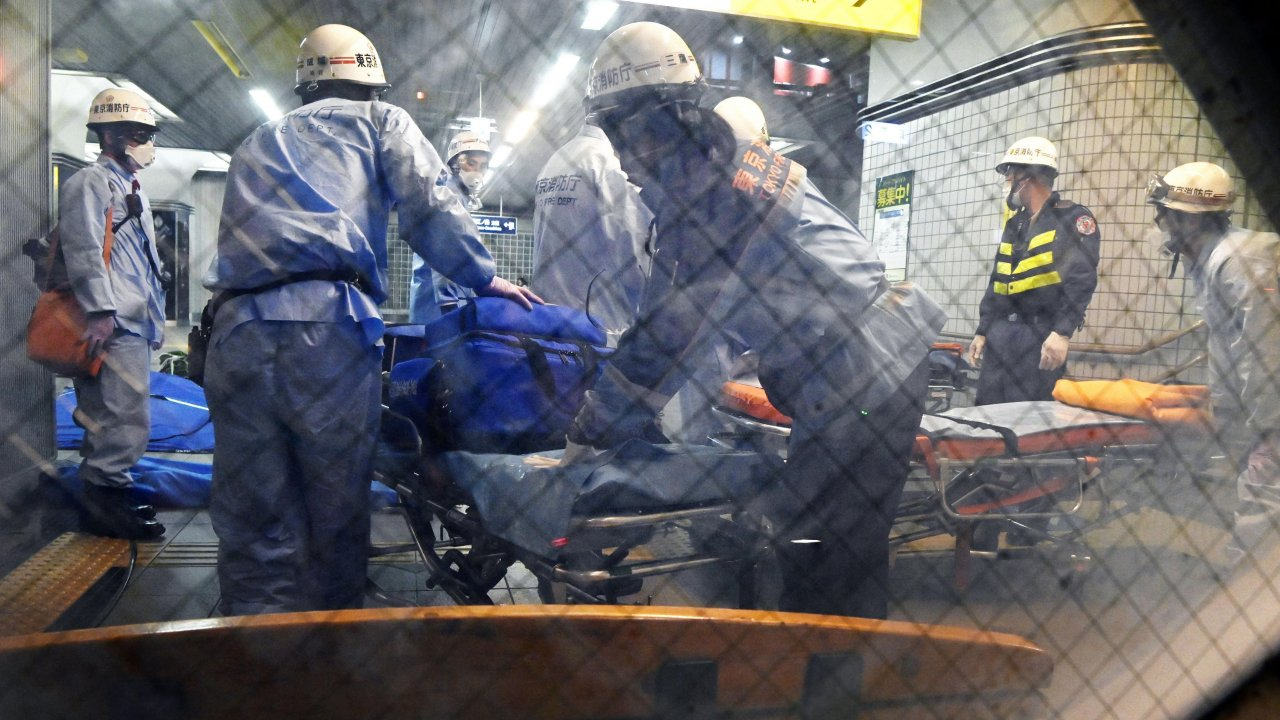 Rescuers papare stretchers at Soshigaya Okura Station after stabbing on a commuter train