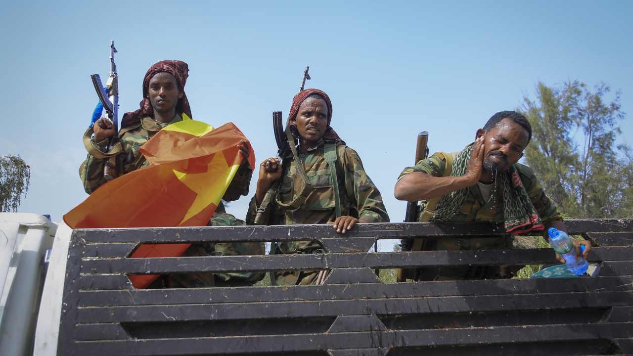 Tigray forces ride in a truck after taking control of Mekele