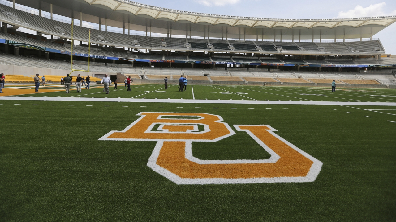 The Baylor University logo is displayed on the football field at McLane Stadium in Waco, Texas.