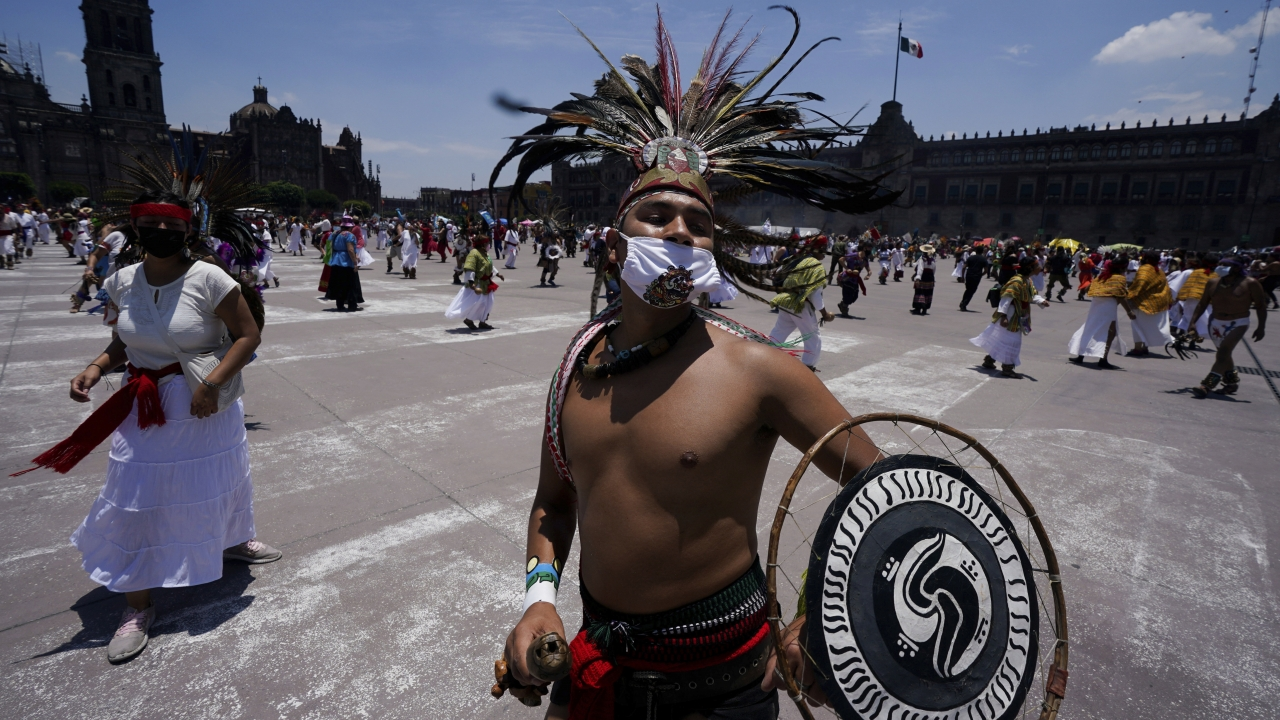 Mexican dancers perform during a ceremony marking the 700 year anniversary of the founding of the Aztec city of Tenochtitlan