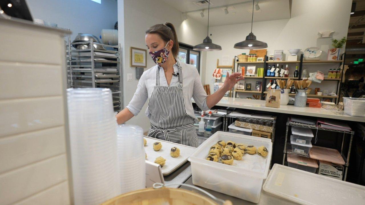 Woman works in kitchen.