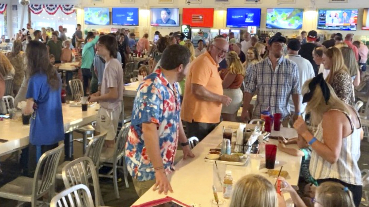 Customers dance inside The Hangout, a popular restaurant in Gulf Shores, Ala.