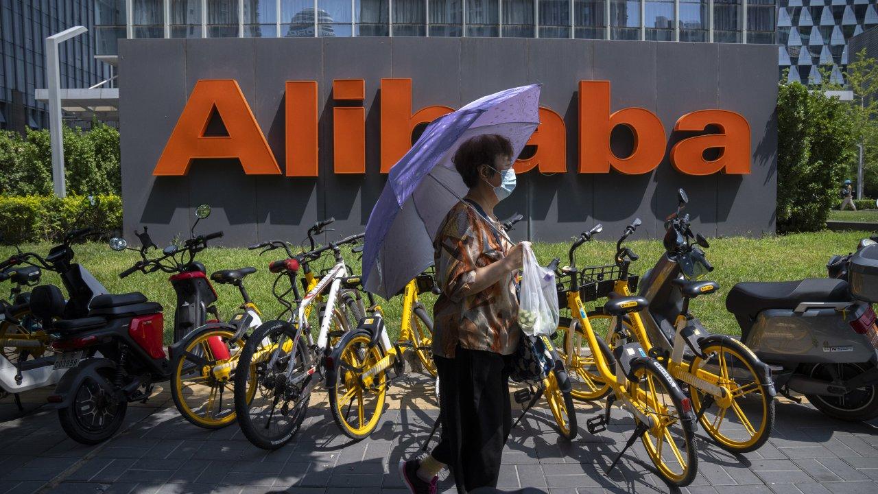 Woman near Alibaba sign