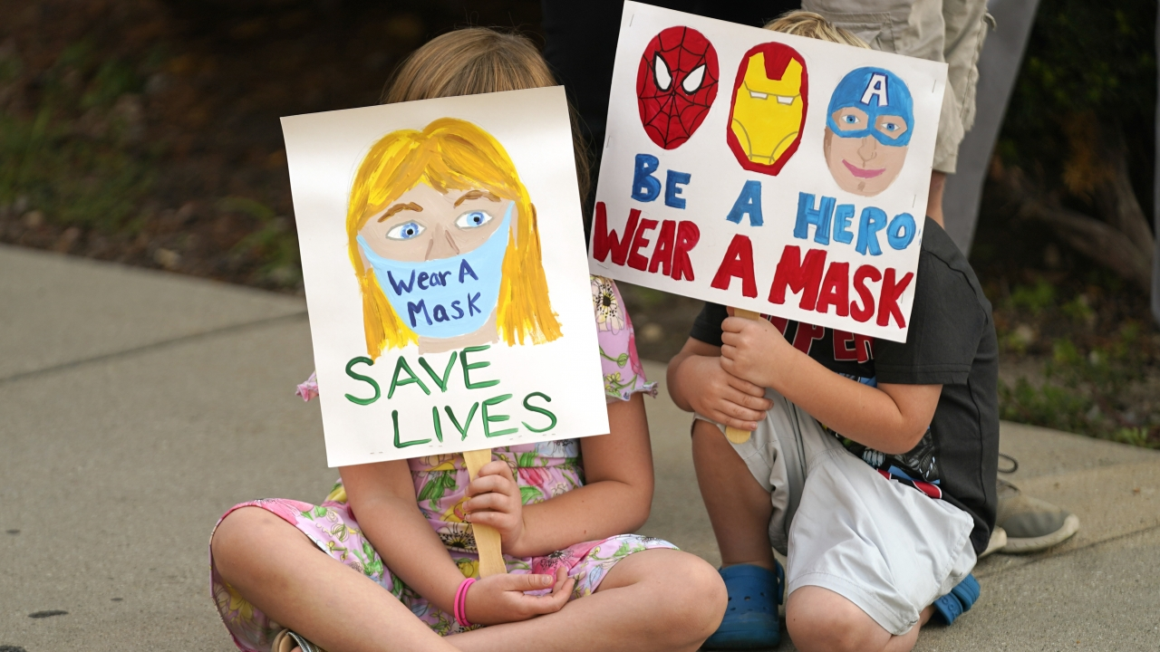 Parents and students during a rally at Utah State School Board Office calling for mask mandate in Salt Lake City