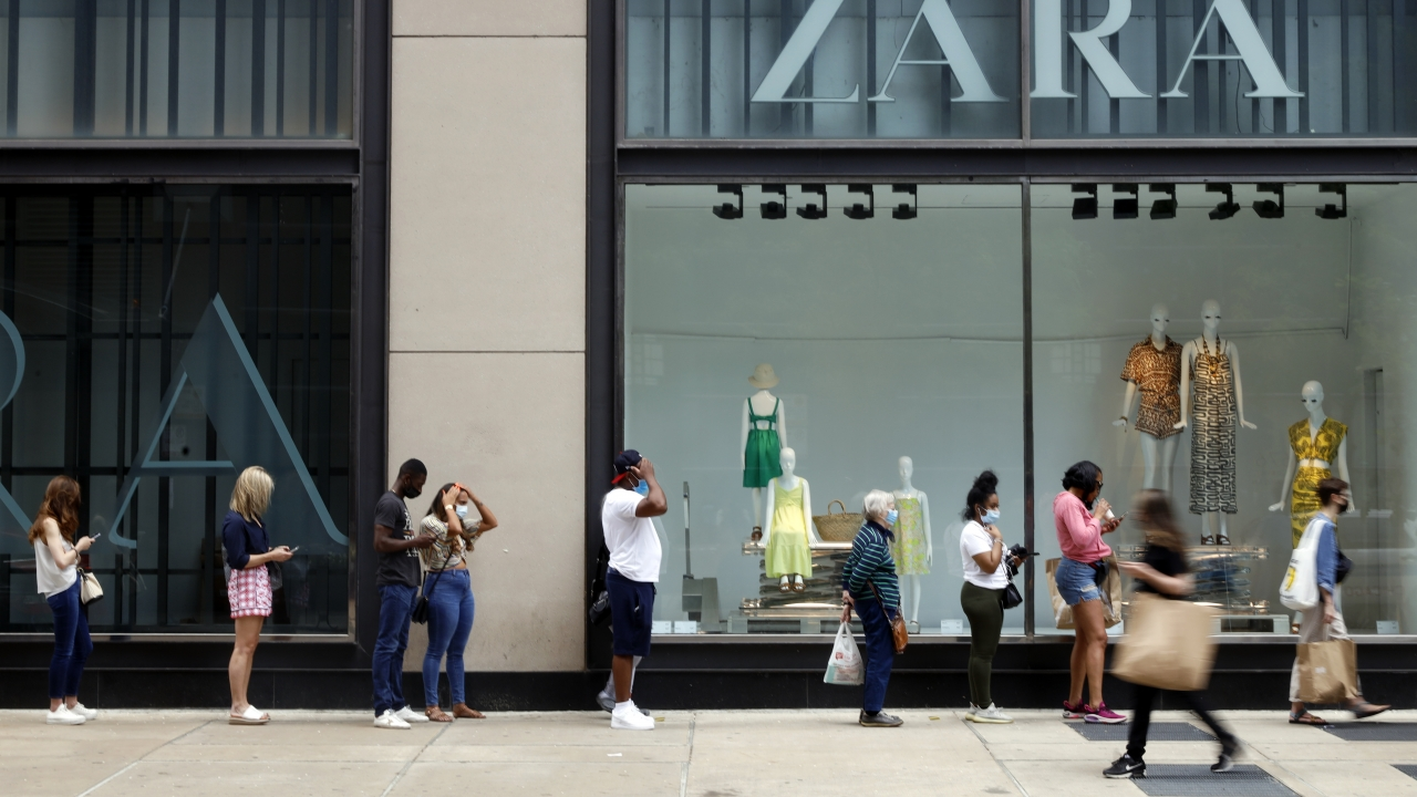 Shoppers wait in line outside a Chicago downtown retail store