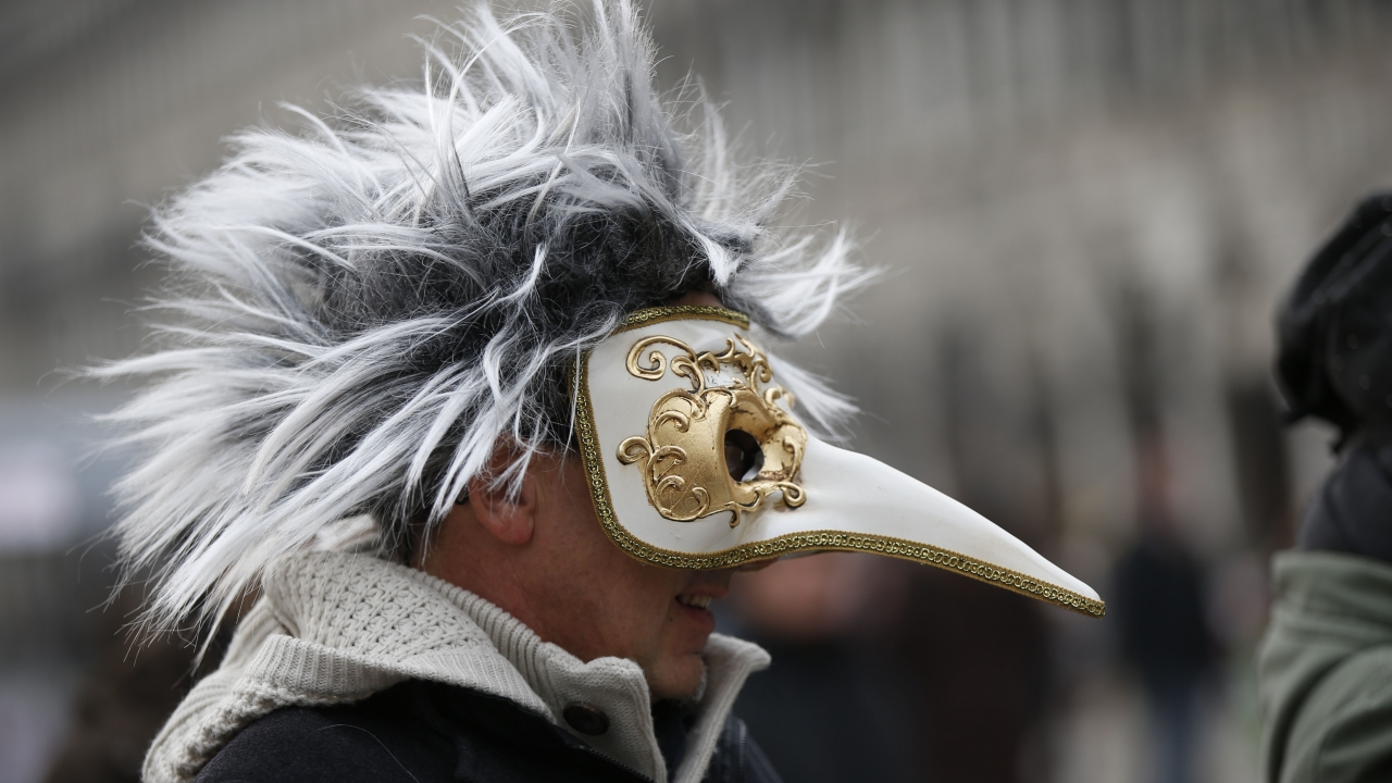 A man wears a pest doctor mask in St. Mark's Square in Venice, Italy.