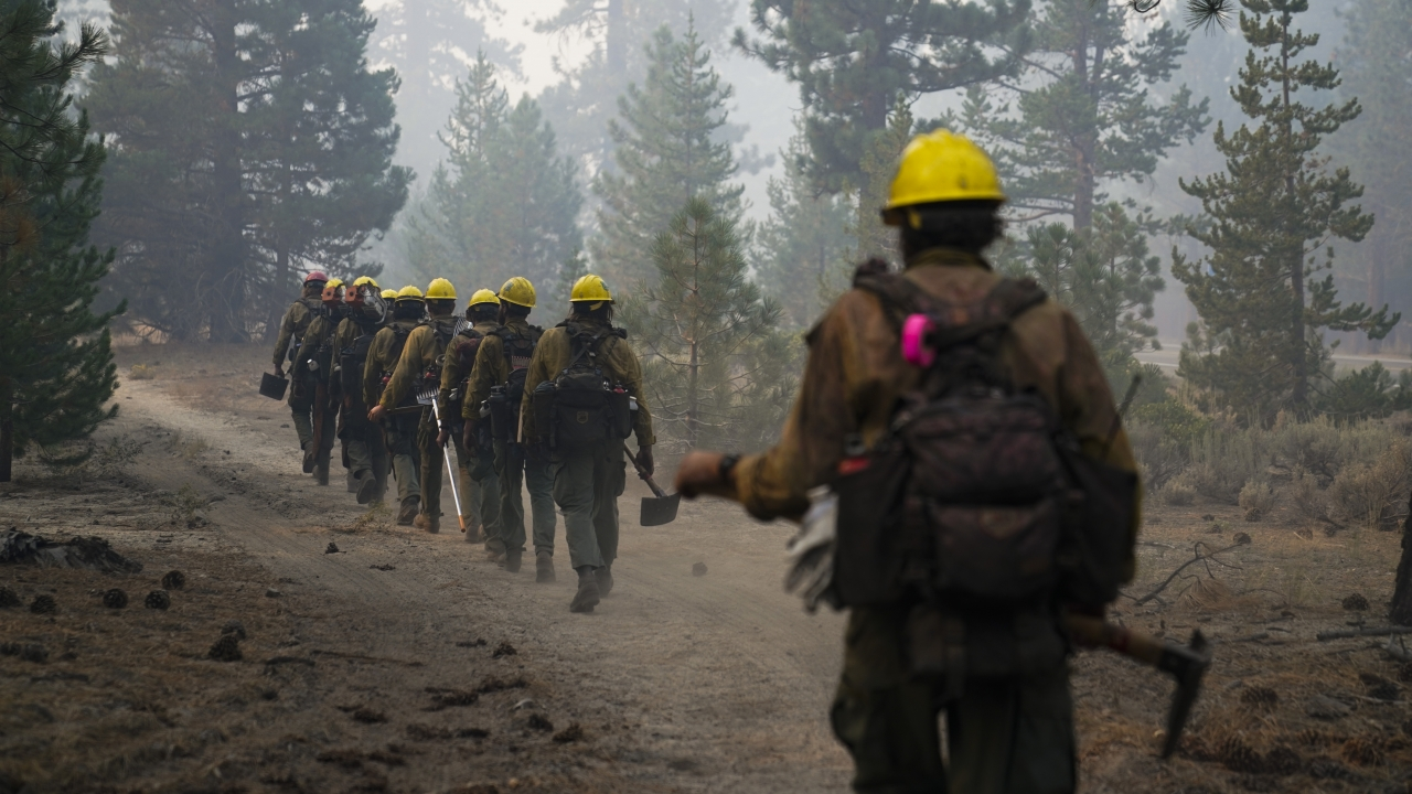 A hotshot crew from Tahoe Hotshots hikes along a trail in Meyers, California