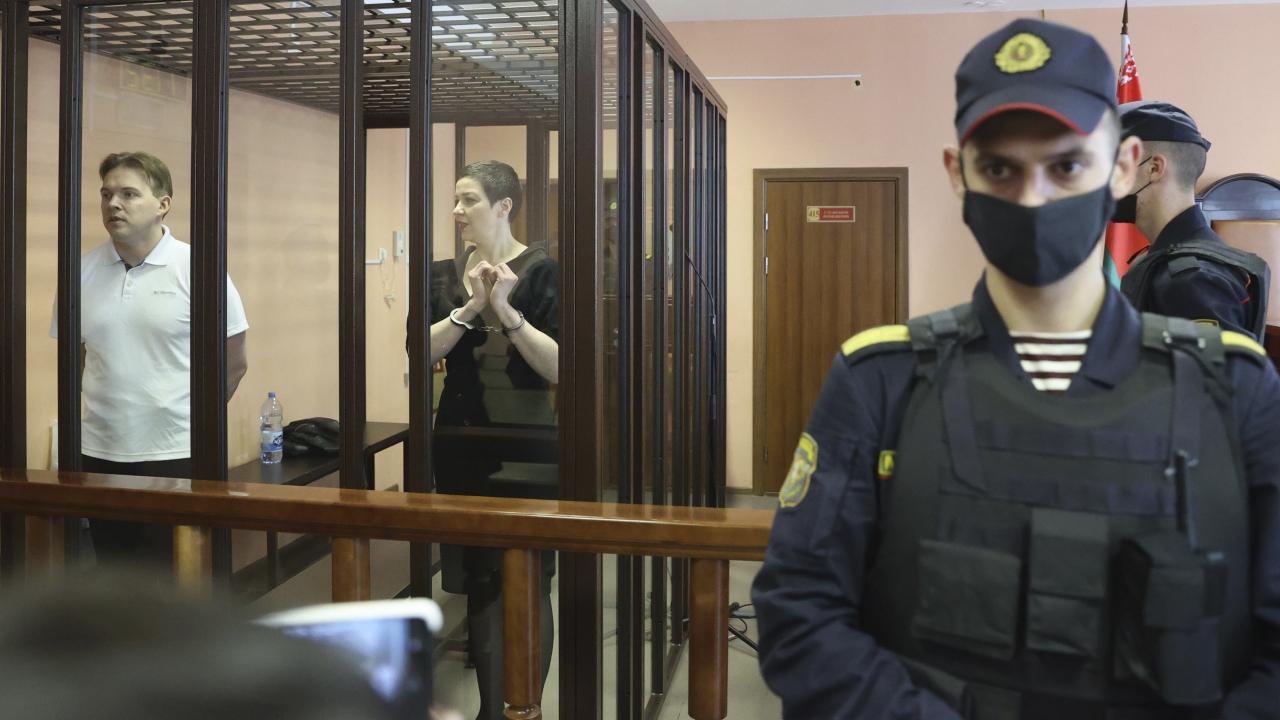 Belarus' opposition activists Maria Kolesnikova and Maxim Znak attend a court hearing in Minsk, Belarus, Monday, Sept. 6.