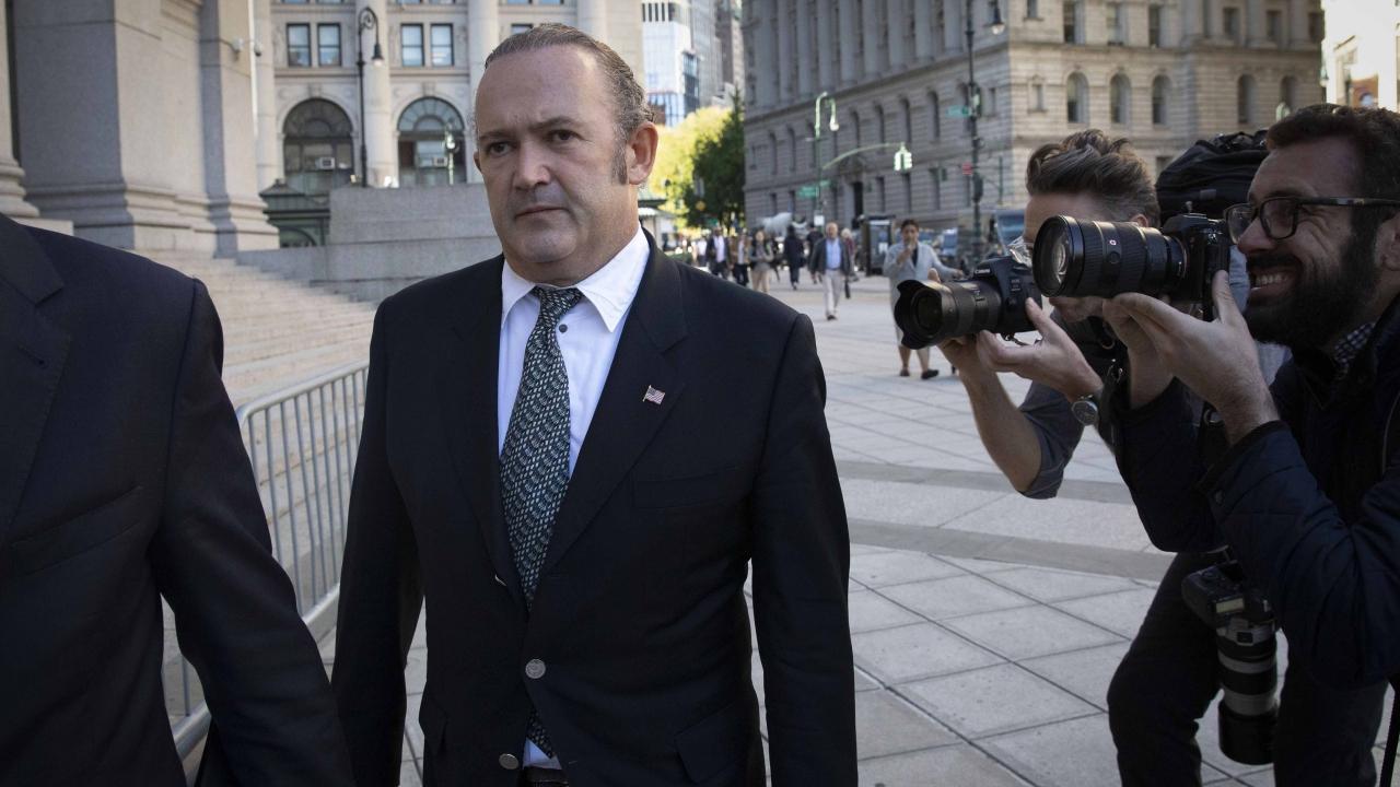 Igor Fruman arrives for his arraignment in New York.