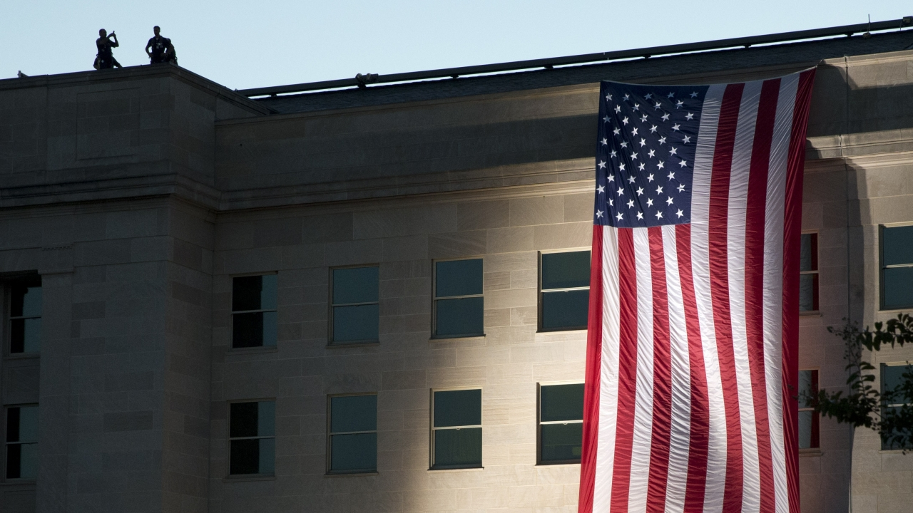 On Sept. 11, 2015, an American flag is draped on the side of the Pentagon where the building was attacked Sept. 11, 2001.