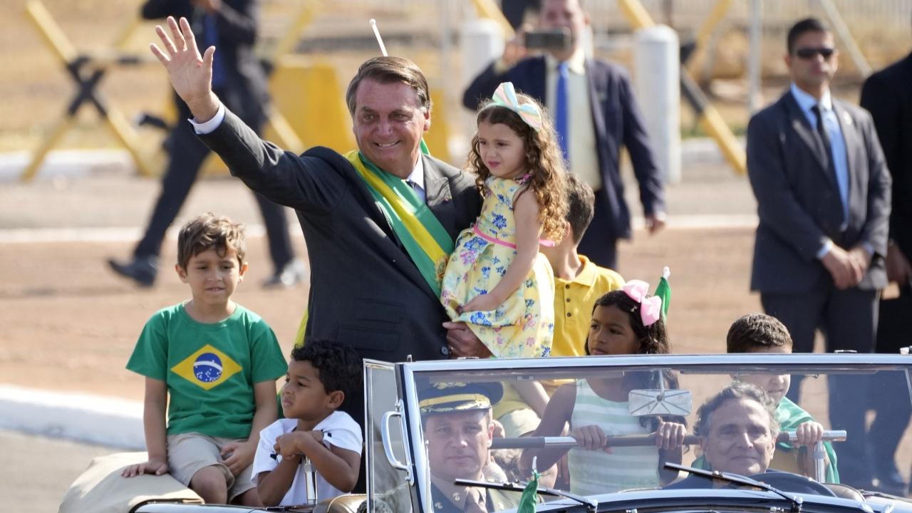 Brazilian President Jair Bolsonaro arrives for a flag raising ceremony at Alvorada Palace presidential residence.
