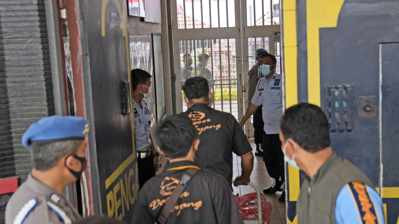 Staff and police officers guard the main entrance gate of Tangerang prison near Jakarta, Indonesia.