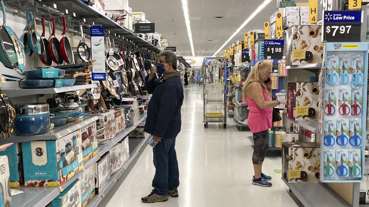 Consumers shop at a Walmart store in Vernon Hills, Ill., Sunday, May 23, 2021.