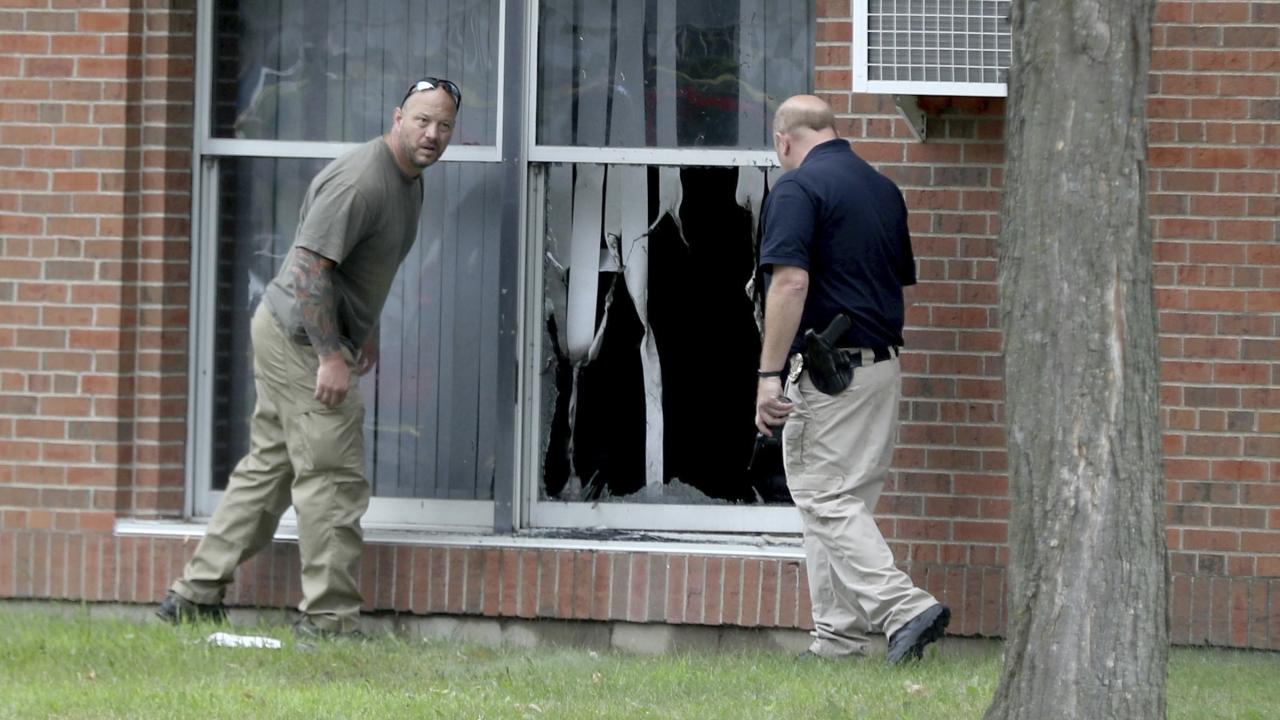 file photo, law enforcement officials investigate an explosion at the Dar Al-Farooq Islamic Center in Bloomington, Minn.
