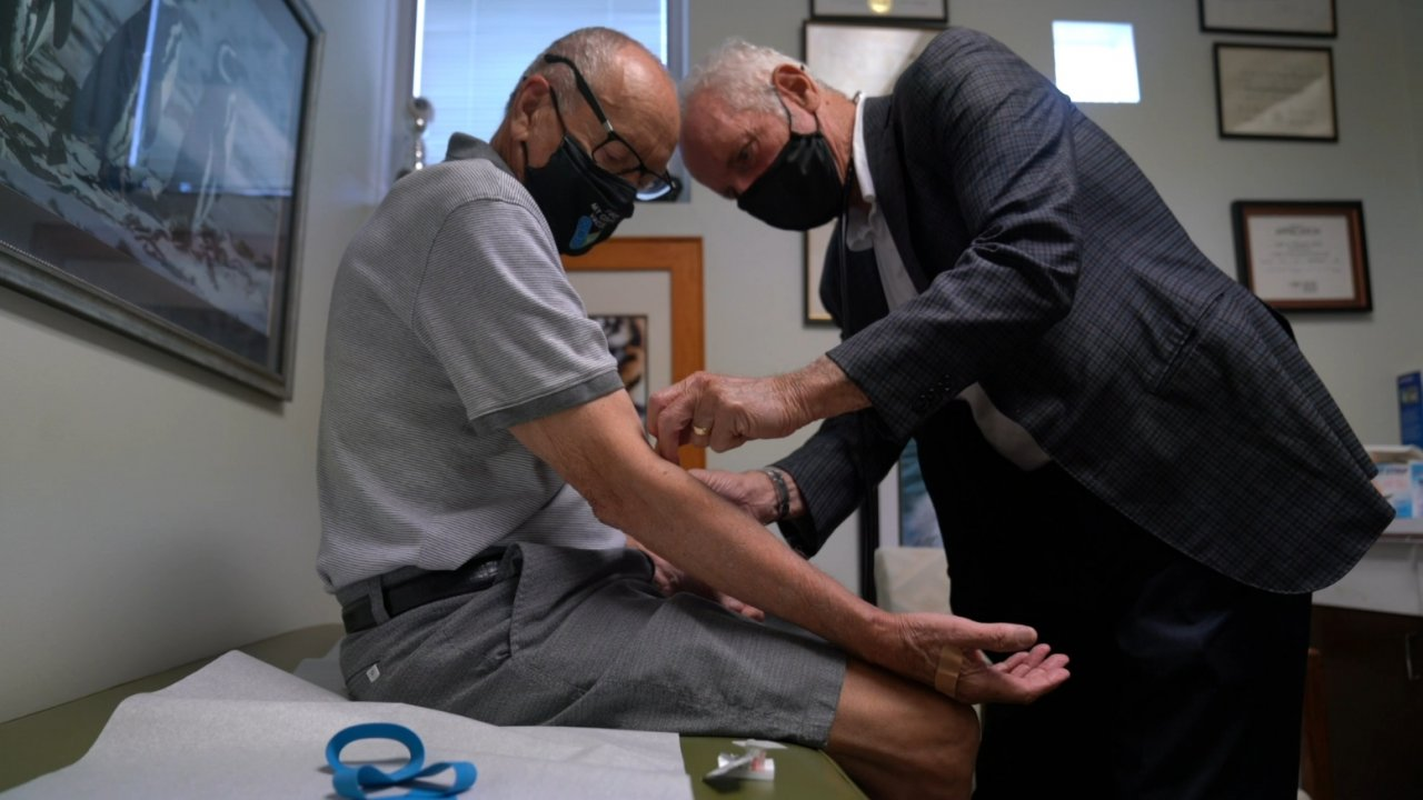Doctor touches a patient's arm.