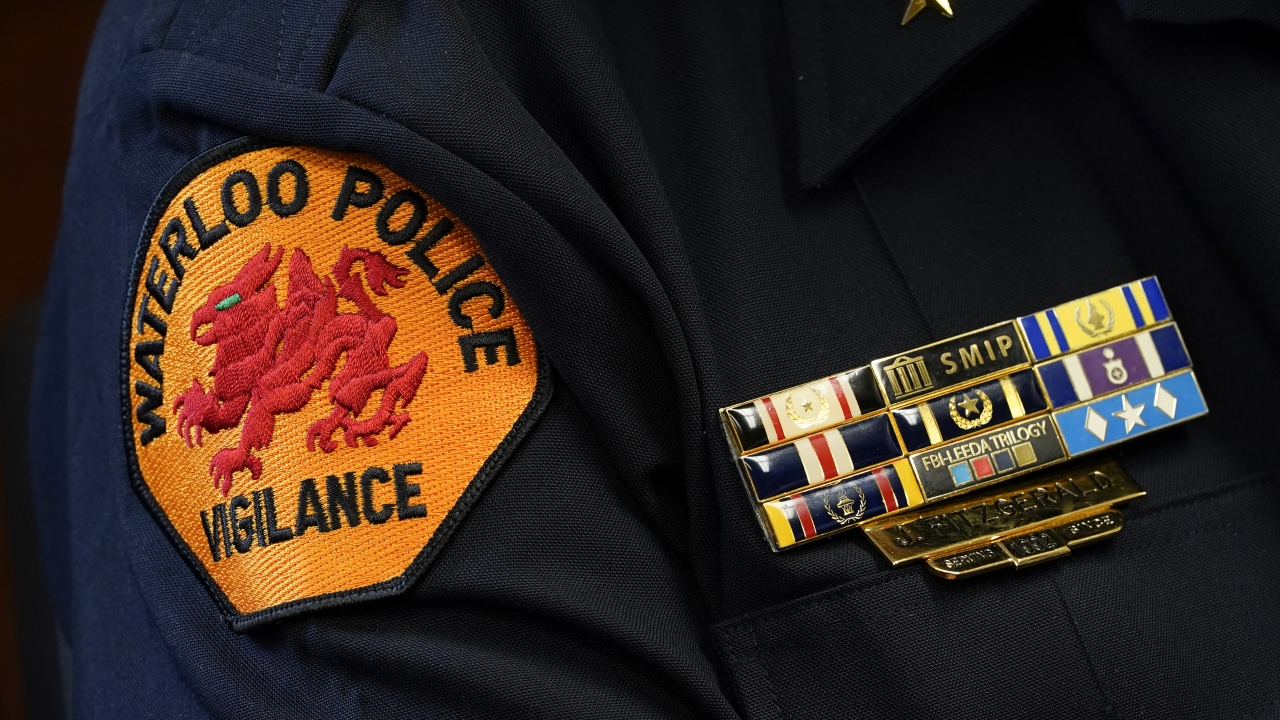 The Waterloo Police Dept. patch is seen on the arm of Chief Joel Fitzgerald