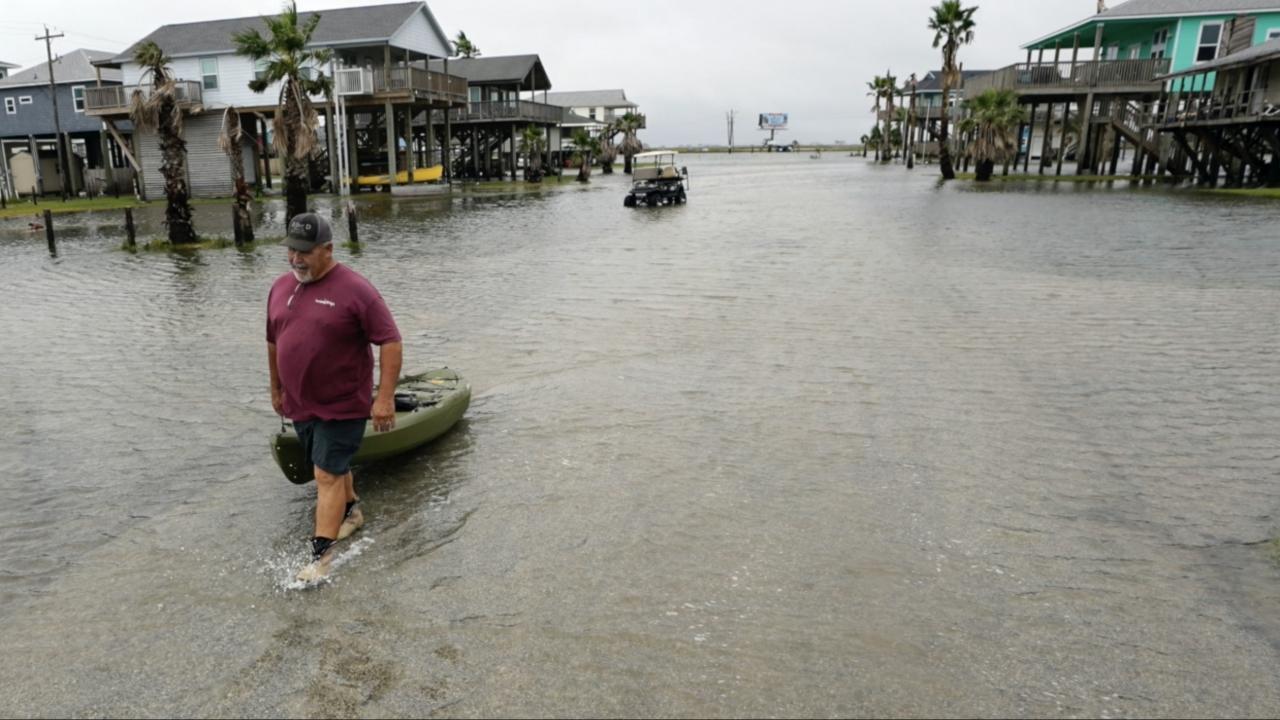 Man walks in flood.
