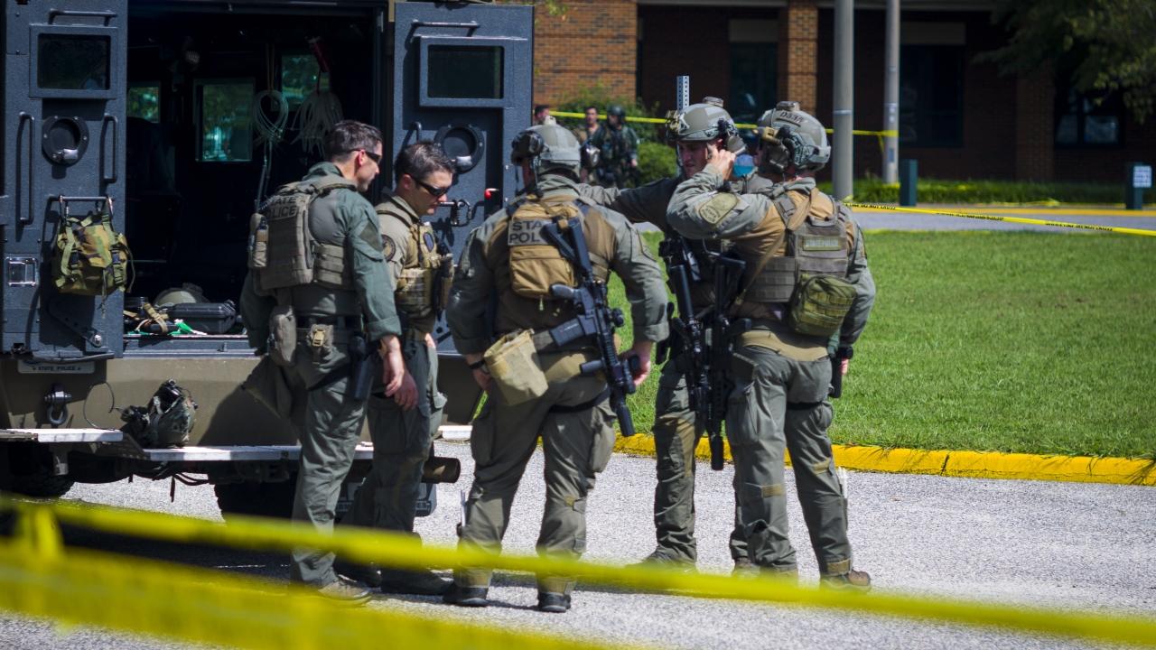 Members of the Virginia State Police SWAT Team gather at Heritage High School in Newport News, Virginia.