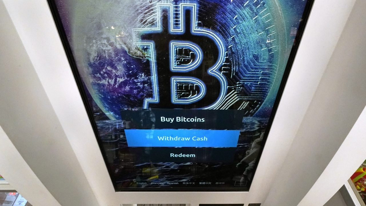 The bitcoin logo appears on a crypto currency ATM.